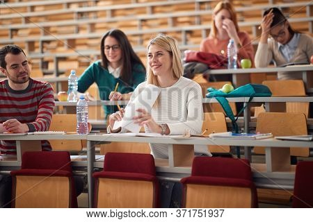 Happy students smiling on lecture in amphitheater