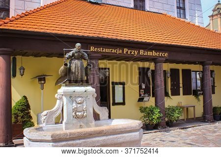 Poznan, Poland - May 05, 2015: Bamberka Figure In Old Town Street Near Town Hall.