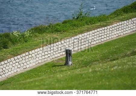 Photo Of A Park Detail With Streetlight, Selective Focus, Green Grass And Sunlight.