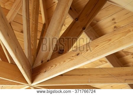 View Of An Pavilion Roof. The Wooden Roof. Wooden Ceiling Of The Roof. Interior View Of A Wooden Roo
