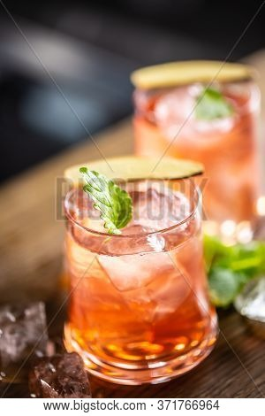 Cranberry Cocktail Sea Breeze Detail With Ice And Mint Leaf.