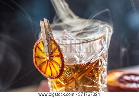 Detail Of A Smoked Old Fashioned Rum Cocktail.