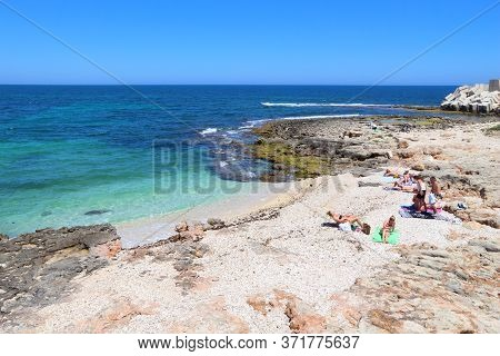 Monopoli, Italy - May 29, 2017: People Visit Bech Near Monopoli, Apulia Region, Italy. With 50.7 Mil