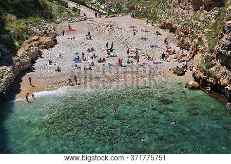 Polignano A Mare, Italy - May 29, 2017: People Visit The Unique Beach Of Polignano A Mare In Apulia,