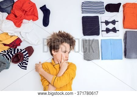 Boy Next To A Bunch Of Clothes, The Concept Of Order And Chaos, Neatness And Mess, Awkward Age