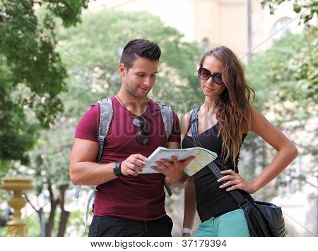 Young couple watching the city map