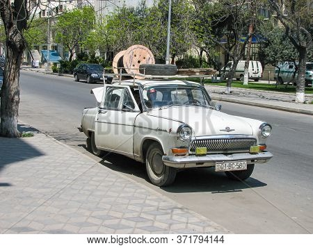 Azerbaijan, Baku - April 29, 2007: Classic Soviet Vintage Sedan Car Volga Gaz With Trunk That Is Ove