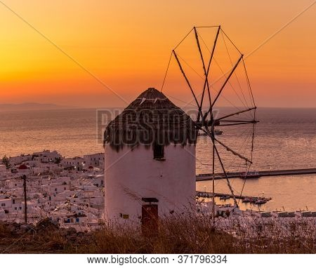 Mykonos, Greece - Oct 15, 2019. Scenic View Of Famous And Traditional Greek Windmill In Mykonos Isla