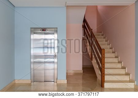 View Of The Elevator And Stairwell In The Entrance Of A Residential Building