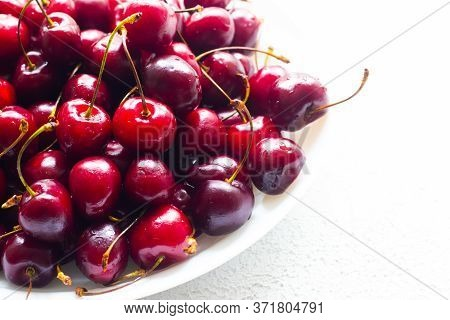 Cherry Berry On A White Plate . Summer Berry. Berries On A Plate On A White Background. Article Abou
