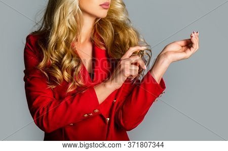 Beautiful Girl Using Perfume. Woman With Bottle Of Perfume. Perfume Bottle Woman Spray Aroma. Woman