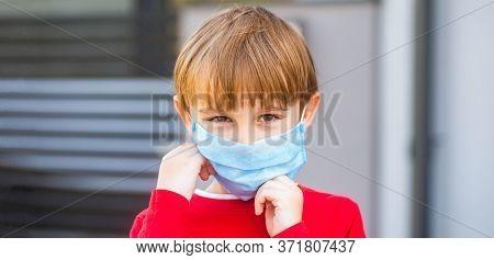 Boy In A Surgical Bandage. Boy In A Medical Mask. Quarantine And Protection Virus. Coronavirus Quara