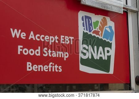 Logansport - Circa June 2020: Snap And Ebt Accepted Here Sign. Snap And Food Stamps Provide Nutritio