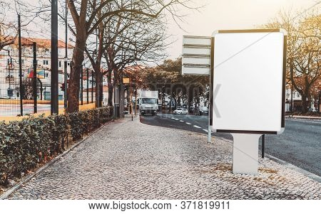Blank White Advert Billboard Template On A Paving Stone Near The Road; Empty Ad Banner Placeholderm