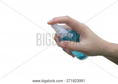 Hand Of Asian Woman Applying The Alcohol Spray With Greenery Background. Closed Up Alcohol Spray. Ki