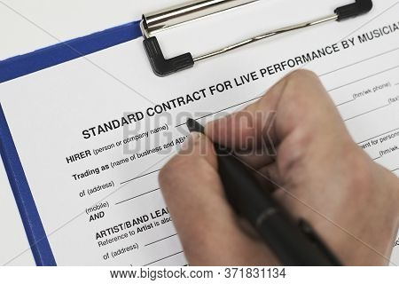 Signing Standart Contract For Live Performance By Musicians. A Musician Filling Live Performance Con