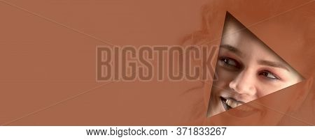 Beautiful Girl With Brown Shadows And Expressive Eyebrows Looks Into The Hole Of Translucent Colored