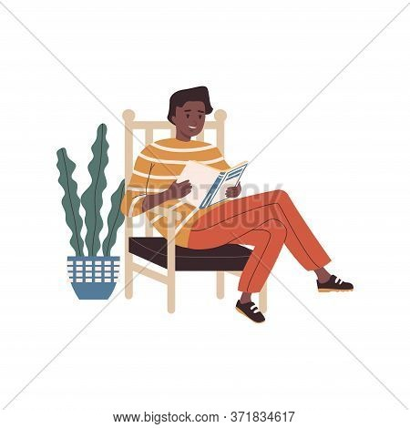 Young Man Reading Book. Young Man With Literature In Hands Sitting On Cozy Armchair At Home. Student