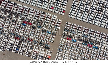 Aerial Top View Of New Cars Lined Up At Industrial Factory Port, Logistics Import - Export And Trans