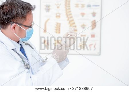 A Close-up Picture Of A Male Doctor Holding A Syringe With Vaccination, Influenza Medicine, Male Doc