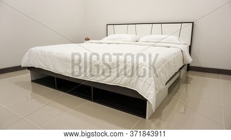 King Size Or Queen Size Bed With Covers, Duvet And Pillows. Decorated Bedroom Furniture With Walls,