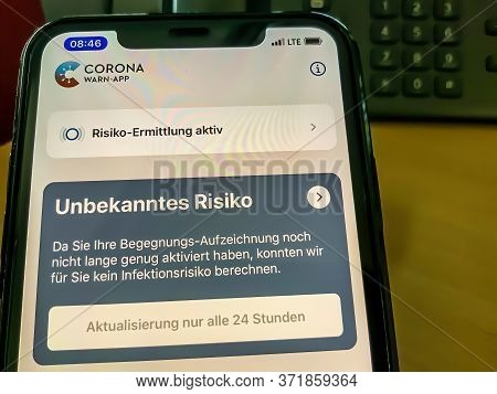 Cologne, Germany - 16th June 2020: A  German Photographer Downloading The New Corona Warn App On Ios