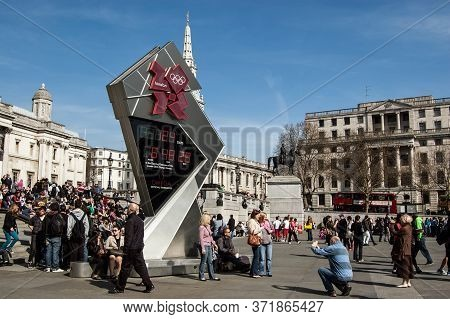 London, Uk - March 25, 2012:  Tourists Gathering Around The Clock Counting Down The Time Until The S