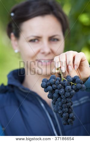 Woman Showing Red Grape