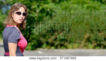 Pretty Young Woman Doing Rollerskate On A Track In The French Alps