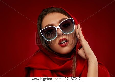 Portrait Of Chic Brunette Sexy Girl With Luxurious Make-up In White Sunglasses And Red Headscarf On