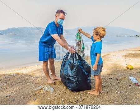 Young Happy Family Activists Collecting Plastic Waste On Beach. Dad And Son Volunteers Clean Up Garb