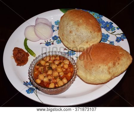 Close Shot Of Traditional Indian Dish Chole Bhature (chickpea Gravy With Fried Bread). Choley Bhatur