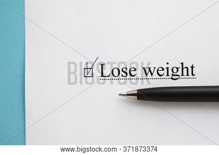 A Piece Of Paper With The Inscription Lose Weight From To Do List With A Tick