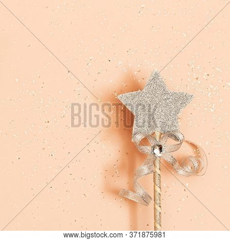 Glowing, Glittering Star On Pink Background. Minimal  Greeting Card For New Year Or Christmas Holida
