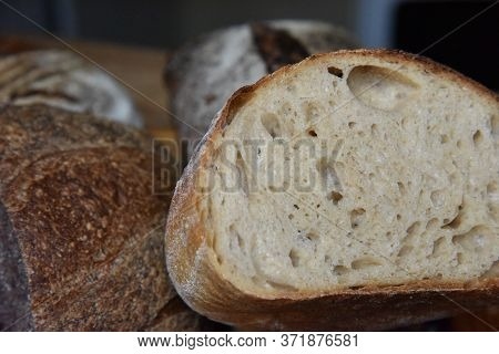A Fresh Crusty Loaf Of Homemade Bread. Homemade Rustic Sour. Brown Bread. Different Types Of Loaves.