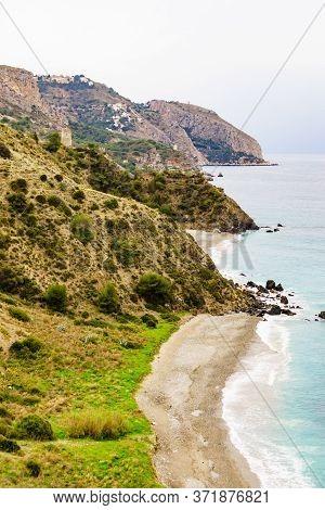 Tower On Spanish Coast, Seaside Cliffs Of Maro Cerro Gordo. Costa Del Sol, Andalusia Spain.