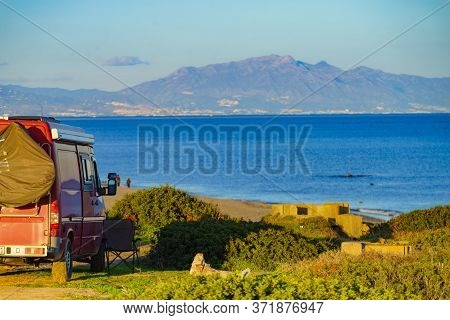 Camper Van On Mediterranean Coast, Beach Torrecarbonera, Punta Mala, Alcaidesa, Spain. Vacation And
