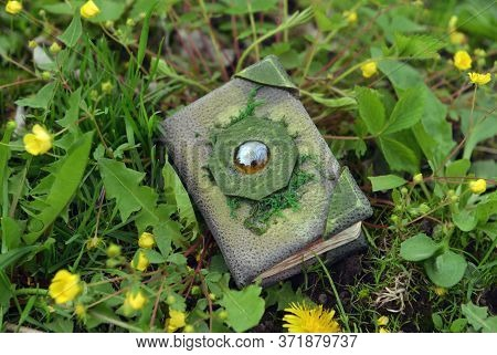 Decorated Magic Book Of Fairy Tales Outdoors In The Garden. Esoteric, Gothic And Occult Background W