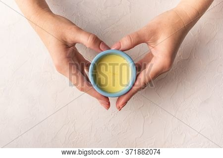 Womens Hands In The Shape Of A Heart Hold Blue Ceramic Cup With Traditional Indian Masala Chai Tea.