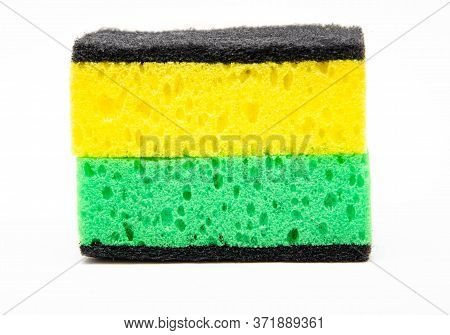 Sponge For Washing Dishes On A White Background. Washcloth Of Green And Yellow Color. Two Sponges Ar