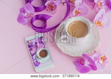 Pink Home Office Workspace With Phone And Coffee Cup. Social Media Flat Lay With Coffee, Flowers And