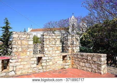 View Of Castle Battlements With St Marys Church (igreja De Santa Maria Do Castelo) To The Rear, Tavi