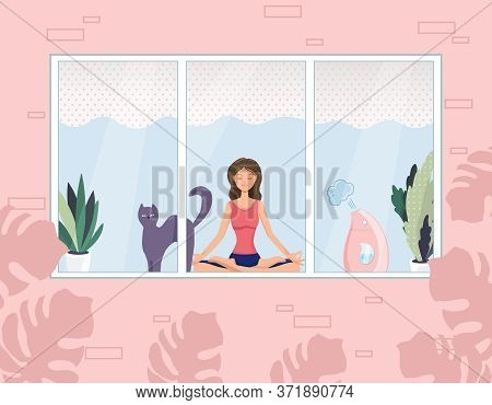 A Nice Young Woman Is Sitting In A Yoga And Meditation Pose With A Cat Next To Her. Meditation, Rela