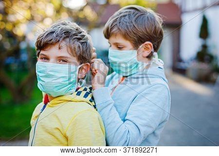 Two Kids Boys In Medical Mask As Protection Against Pandemic Coronavirus Disease. Children, Lovely S