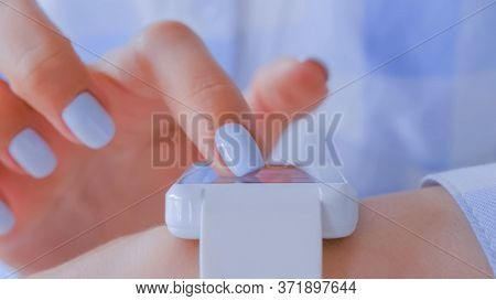 Close Up Front View - Woman Hands With Manicure Using Wearable White Smartwatch Computer Device - Sc