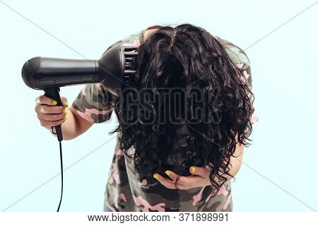 Woman Makes Herself Curly Hairstyle. Girl Using A Modern Hairdryer. Haircare Concept. Woman Drying H