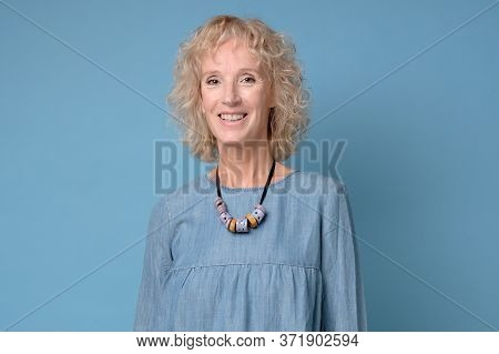 Senior Woman Smiling Looking Confident At Camera.