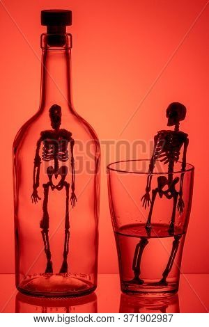 A Silhouette Of A Skeleton In A Bottle And A Silhouette Of A Skeleton In A Glass With Liquid. Drunke