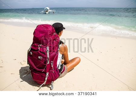backpacker on beach