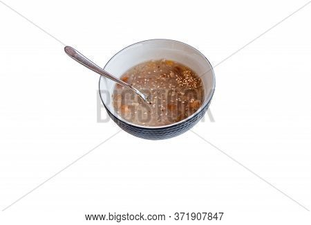Traditional Turkish Dessert Ashure Or Noah's Pudding With Spoon Isolated On White Background.